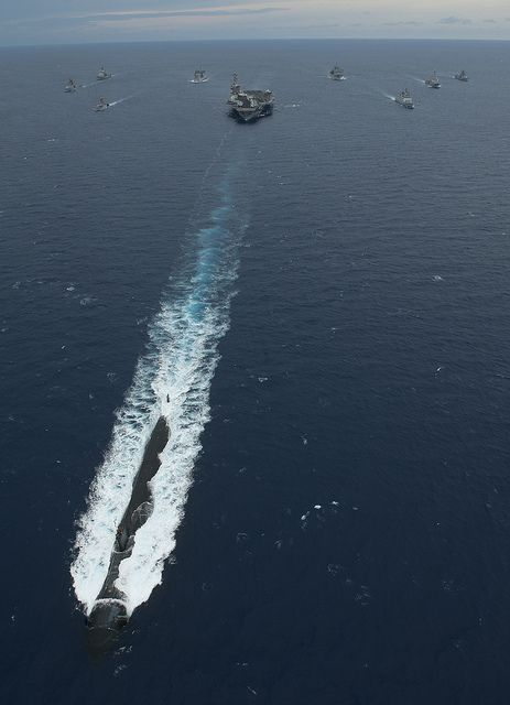 Rare shot of battle group's sub.  BAY OF BENGAL (April 14, 2012) USS Topeka (SSN 754) leads USS Carl Vinson (CVN 70), USS Bunker Hill (CG 52), USS Halsey (DDG 97), USNS Bridge (T-AOE 10) and ships of the Indian navy in formation during Malabar, an annual bilateral naval field training exercise between the two navies. (U.S. Navy photo by Mass Communication Specialist 2nd Class James R. Evans)