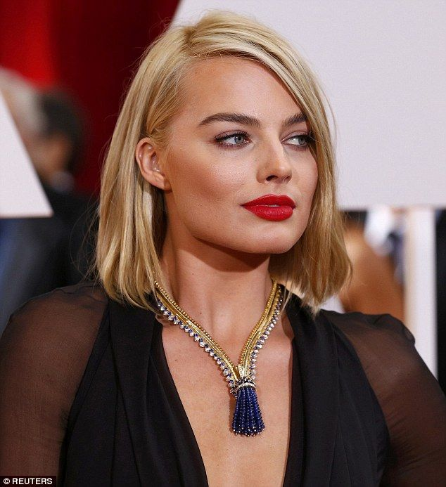 Dazzling: Margot Robbie showcased a striking Van Cleef and Arpels necklace, known as the Zip Antique, with an astonishing price tag of $1.5million on the Oscars red carpet on Sunday night