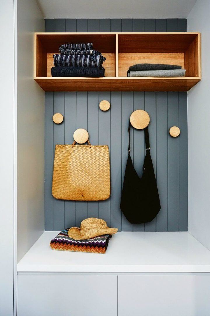 storage-nook-with-grey-timber-panels-and-wall-hooks - for the little area near the laundry
