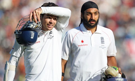 Jimmy Anderson, left, and Monty Panesar leave the field after their 10-wicket partnership survived 69 balls.