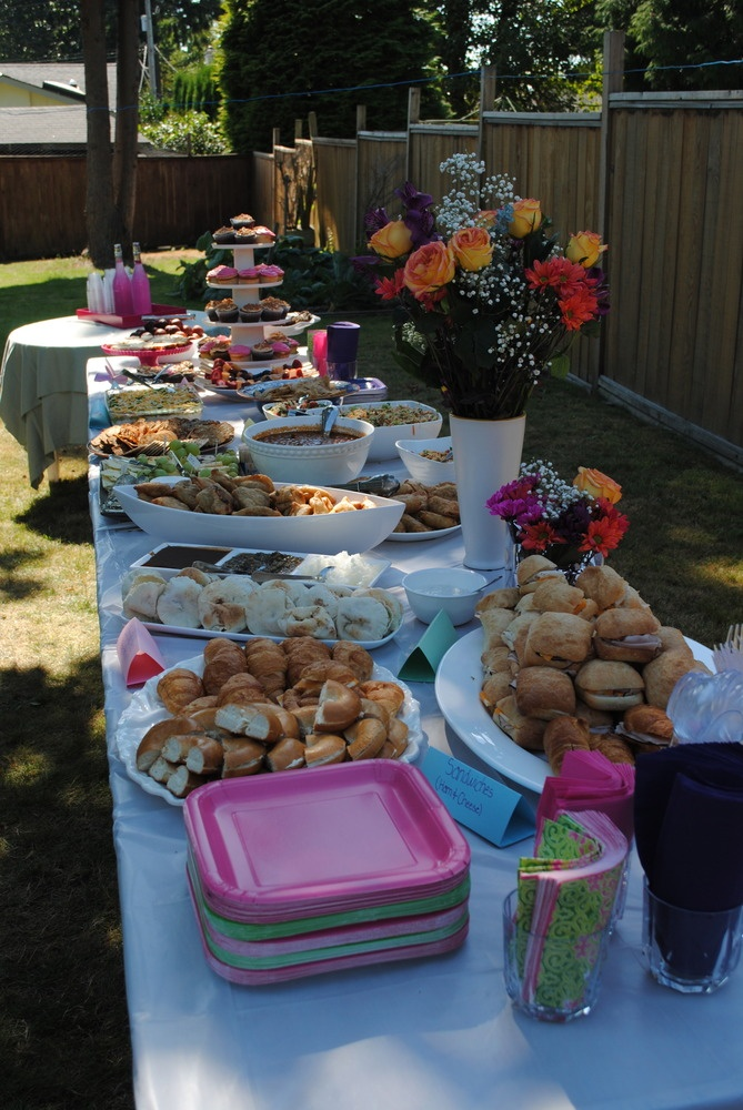 Outdoor Bridal Shower Decor   Food Table With Fresh Flowers And Colorful  Dishes