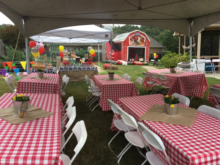 Theme: Old McDonald Birthday Party | Party Venue: Private Residence | Planning, Decorating & Catering: Any Reason To Plan LLC | Cake: Cake Art By Cynthia | Inflatable, Chairs & Tables: Fun Source Rentals, Inc. | Entertainment: 6th Day Creatures