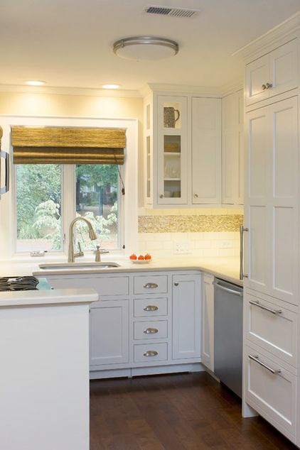Kitchen cabinets to the ceiling is a great storage option. They also help visually expand the space.
