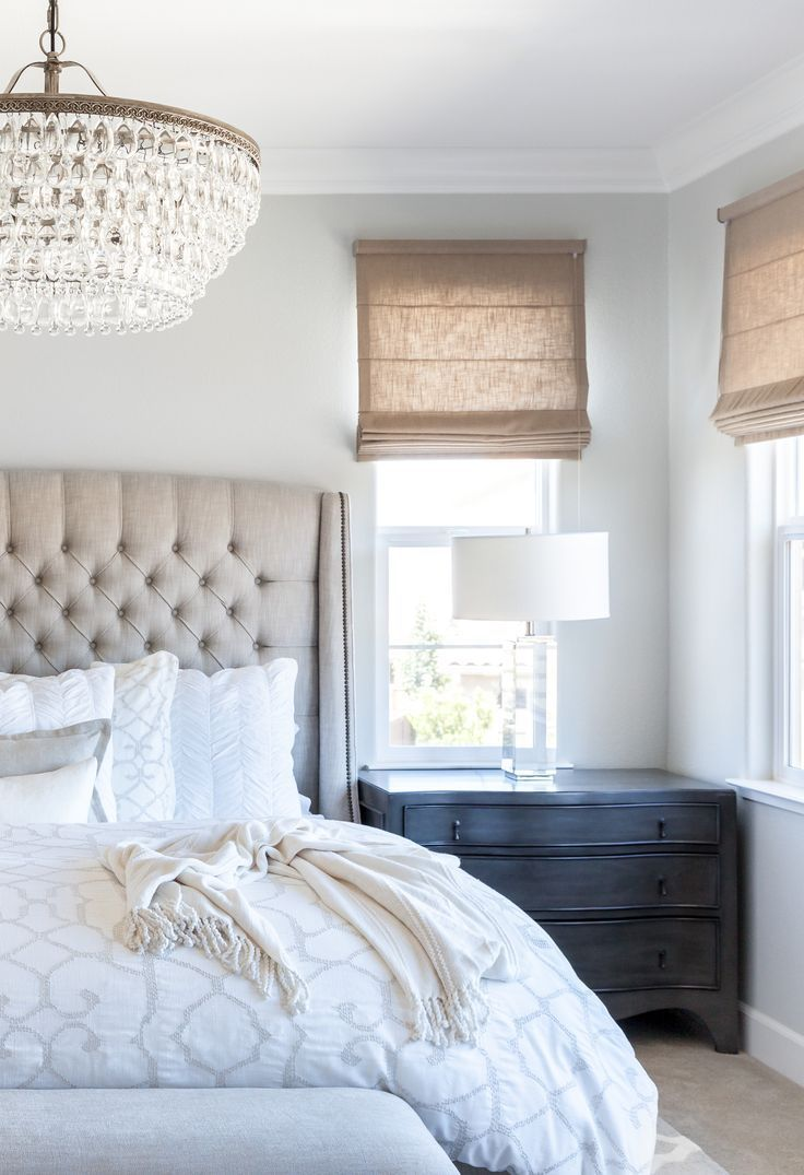 Calming Master Bedroom With A Tufted Linen Bed And Gray Walls Topped Off Crystal Chandelier