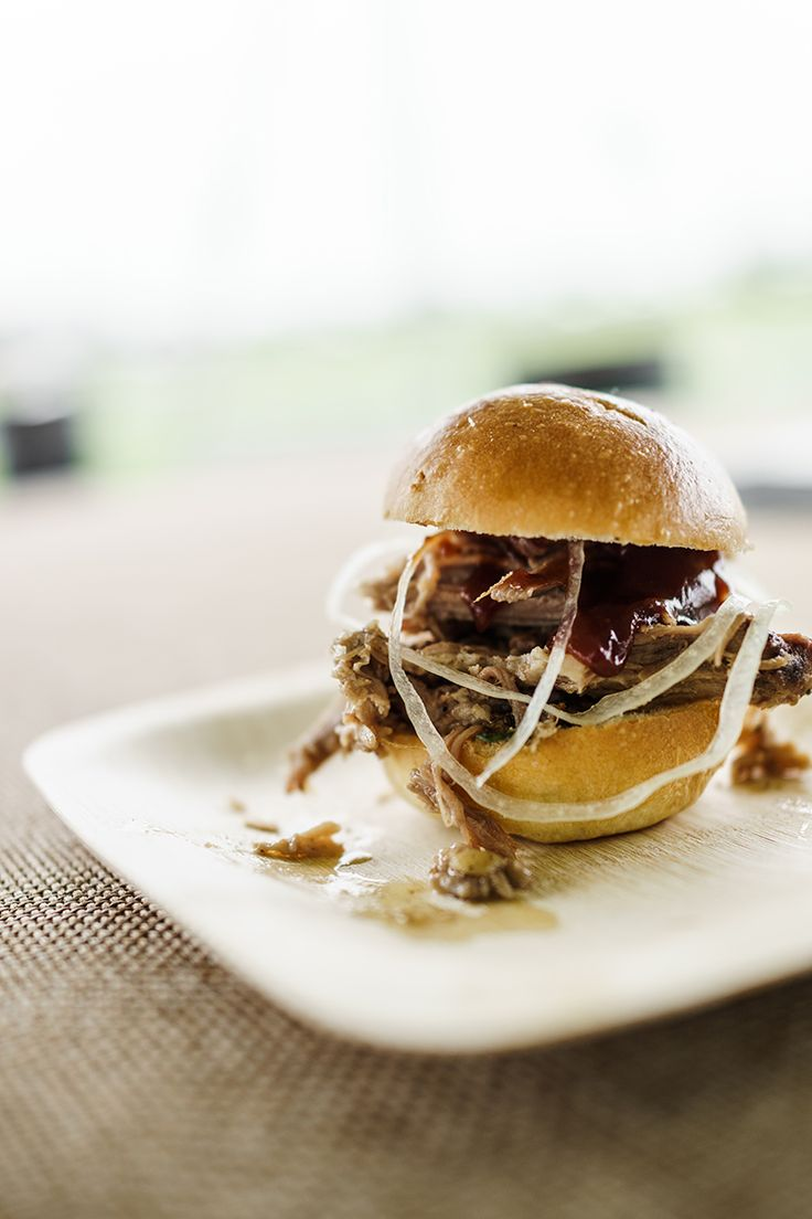 The perfect tailgating menu item: mini pulled pork sliders with Sweet Baby Ray's BBQ Sauce. Served at the Garden & Gun tent at Foxfield Spring Races in Charlottesville, Virginia.