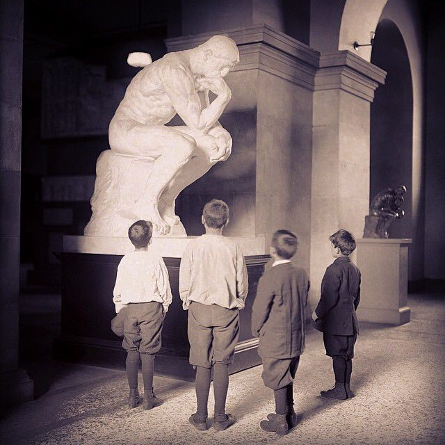 """This photograph of children looking at a cast of Auguste Rodin's """"The Thinker"""" was taken on June 2, 1913. #tbt #metmuseum #rodin"""