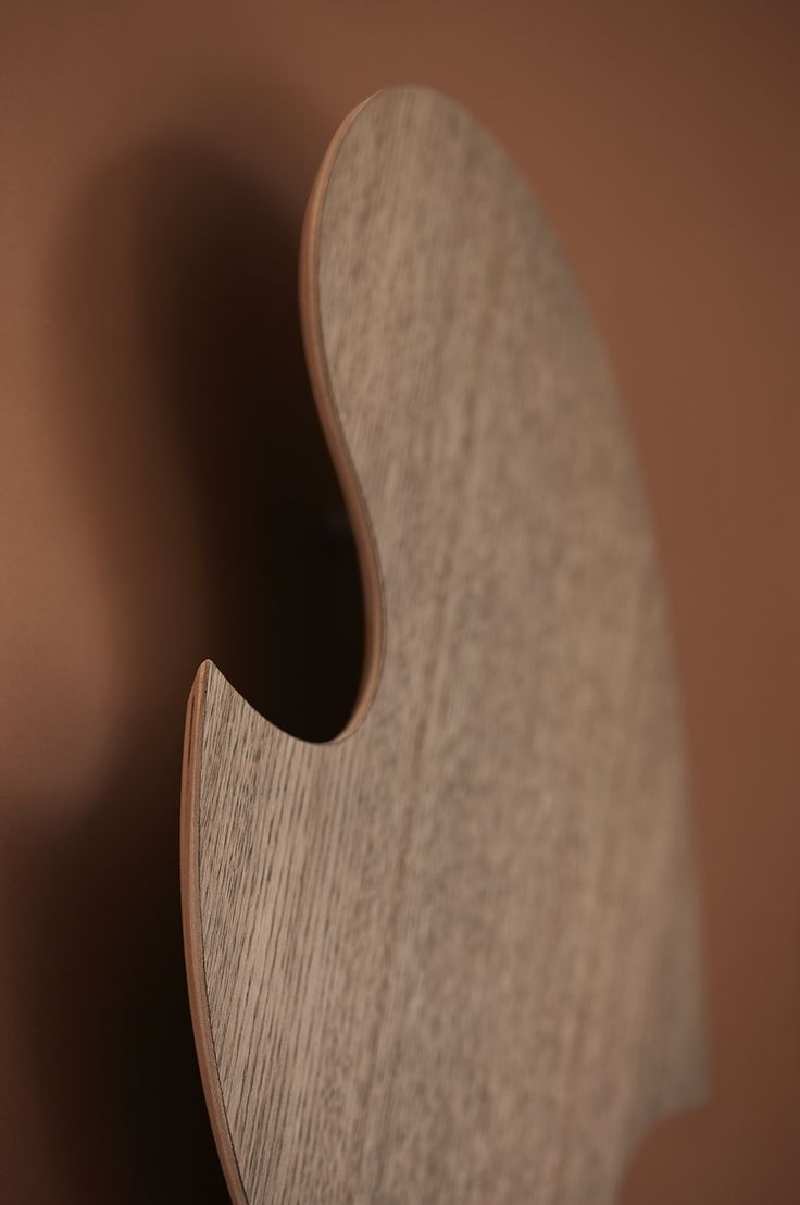 A close up of our Move sculpture in oiled oak.