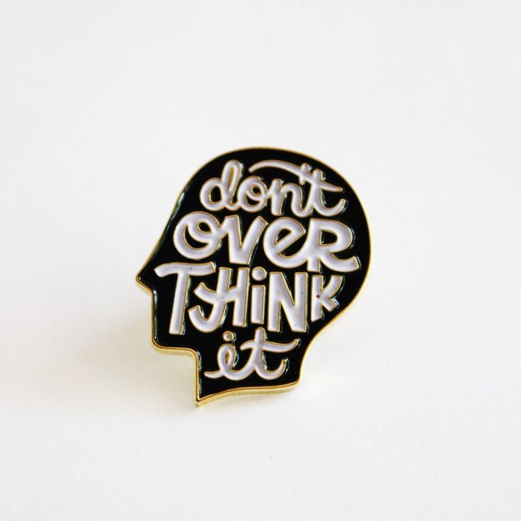 DON'T OVERTHINK IT enamel pin die struck enamel pin 1 inch tall black and white design on gold metal pin back featuring a popular type...