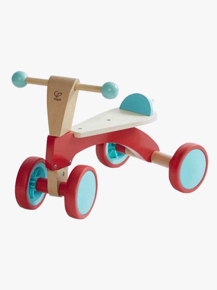 Porteur trotteur en bois Hape multicolore - C'est qui l'as du guidon ? Idéal pour permettre aux petits d'acquérir le sens de l'équilibre avant le passage au vélo 2 roues.   DIMENSIONS : haute