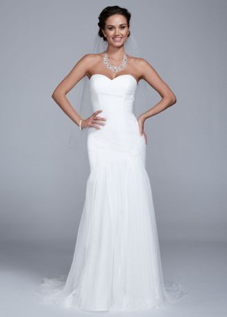 Elegant and stunning, this tulle trumpet gown is the epitome of timeless beauty!  Strapless sweetheart gown featuresaultra flattering ruched banded bodice.  Trumpet skirt adds movement and creates drama.  Available in Soft White. Sizes 0-14.  Fully lined. Back zip. Imported polyester. Dry clean.