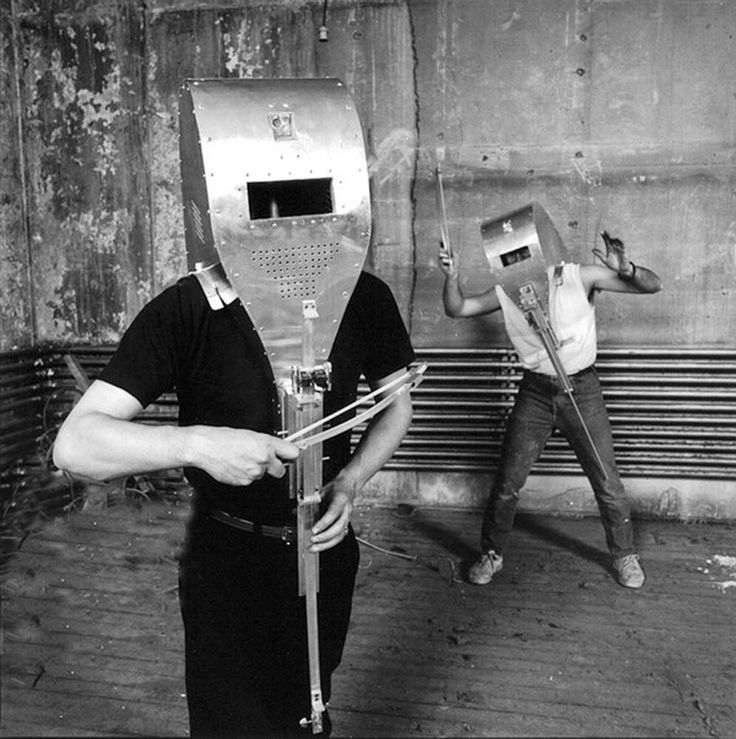 """Pierre Fournier – Masques Sonores, ca.1983  During the 1980s, Québécois sculptor Pierre Fournier, b.1957, created sound-producing automatons and sculptures, including a series of """"Masques Sonores"""", also known as """"Masques Electro-Magnétiques"""", that is, sound producing, wearable helmets he used during various gallery performances in Montréal (Conventum) and Toronto (Music Gallery)."""