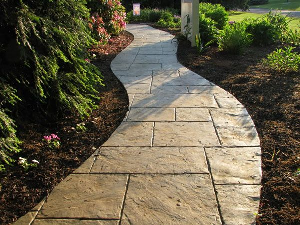 Stamped concrete has the look of natural stone, but the ability to be configured however you'd like.  Note how this curving #pathway is much more interesting to look at than an ordinary rectangular sidewalk.  We design and install #walkways and other #hardscapes in the Minneapolis MN area. http://www.aldmn.com