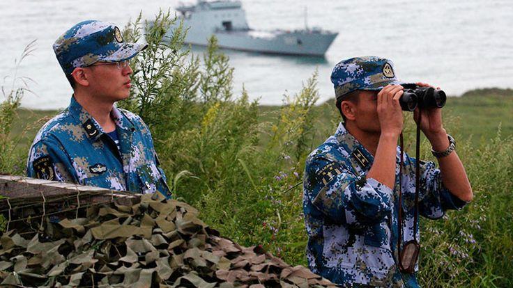 La superficie y otros elementos de la base naval china preocupan a los  analistas estadounidenses, que han estudiado las imágenes de esta única base militar de Pekín en el extranjero obtenidas por satélites espía.