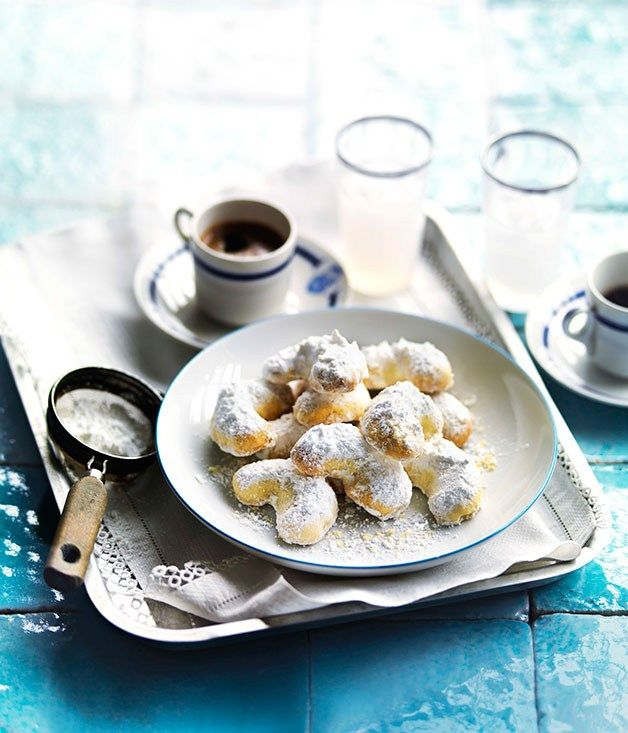 Kourabiedes . Greek sprinkled biscuits with rosewater, dusted heavily with icing sugar. A Christmas treat!