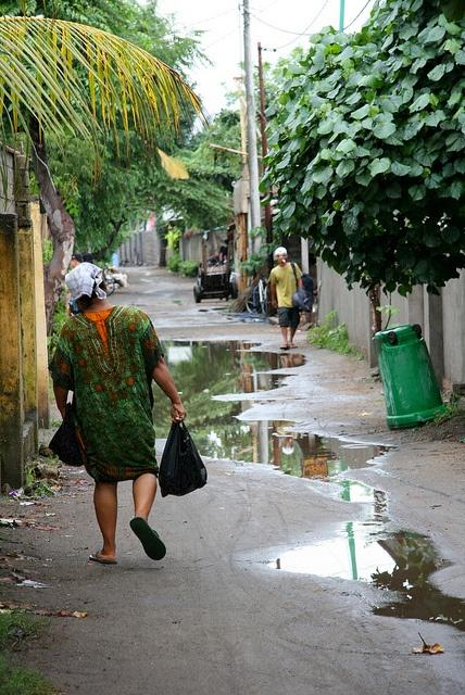 Indonesian woman walking in Gili Trawangan, via Flickr.