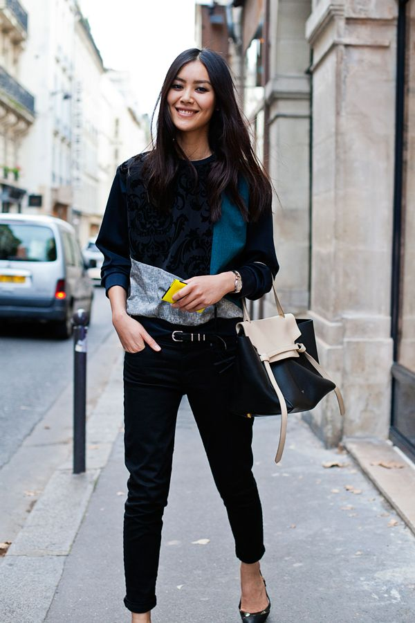 Model Liu Wen looks sexy and chic through adding in small hints of color to her black outfit.
