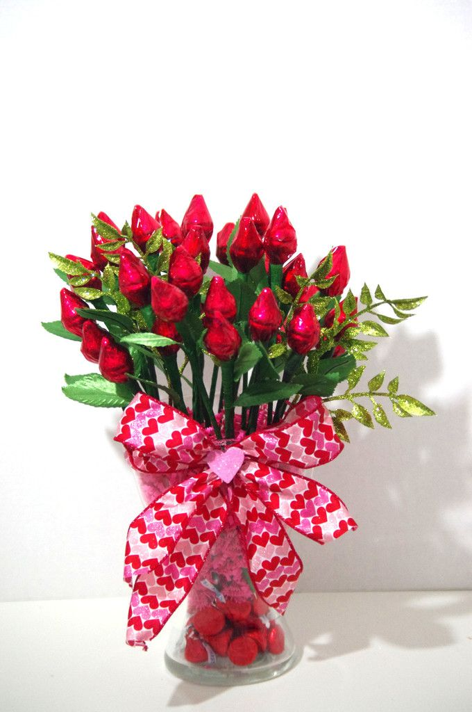 36 roses made from 72 milk chocolate Hershey Kisses. 2 Hershey Kisses are wrapped together to form a beautiful red rose. Roses are arranged in a large glass vase with a heart bow. Additional 24 Hershe