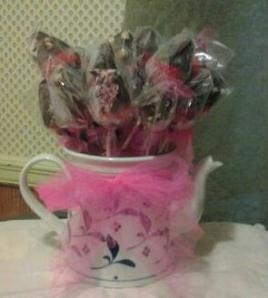 Why spend  over 20.00 for chocolate dipped fruit bouquets? You can make this frugal and easy bouquet at home! this is a easy peasy recipe and a great adorable use of tea pots or mason jars you have laying around the house. Great for Mother's day, birthdays, pot lucks, and even center pieces for a wedding reception.  http://justanothermodestmom.wordpress.com/2012/05/15/chocolate-dipped-strawberry-bouquet-recipe/