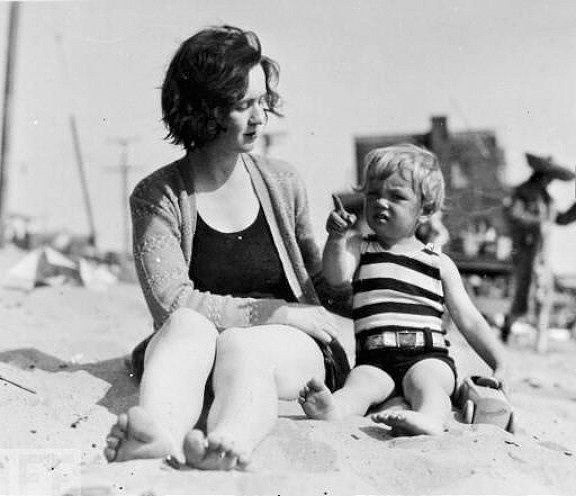 Hollywood film cutter Gladys Baker shares a happy moment at the beach with her 3 year-old daughter Norma Jeane, the future Marilyn Monroe, in 1929.