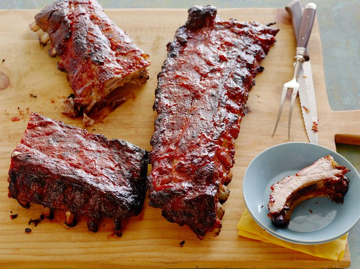 Barbecued Pork Ribs : Feed a crowd with Trisha's game-changing pork ribs. Let the marinade cool before pouring it on so the ribs don't partially cook and become tough. via Food Network