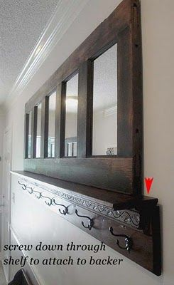 Coat rack made from an old door. We have these kind of doors in our house. I'm sure Bobby could make this.