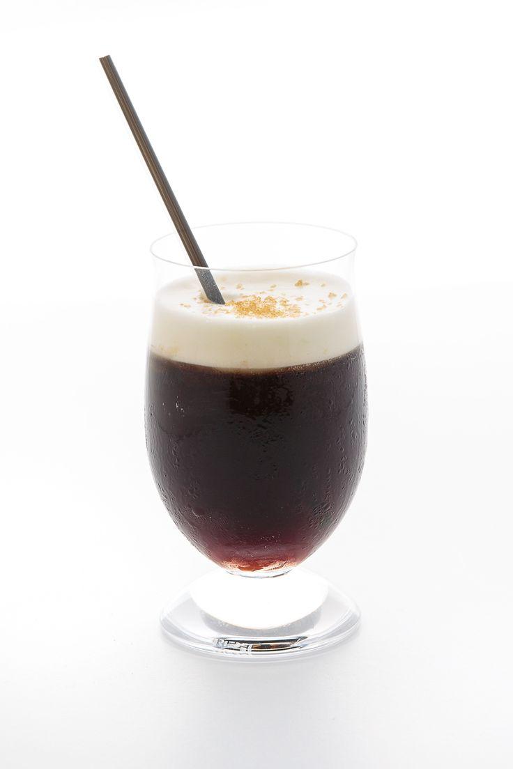 Petit Café 1½ oz. coffee liqueur, preferably Galliano Ristretto 1 oz. green Chartreuse ¼ cup heavy cream, lightly whipped Pinch Demerara sugar, for garnish