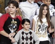 FILE - This Jan. 26, 2012 file photo shows, from left, Prince Jackson, Blanket Jackson and Paris Jackson after a hand and footprint ceremony honoring their father musician Michael Jackson in front of Grauman's Chinese Theatre in Los Angeles. The executors of Michael Jackson's estate say they are concerned about the welfare of the singer's mother and his three children. In a letter posted on fan sites Tuesday, July 24, executors John Branca and John McClain says they are doing what they can…