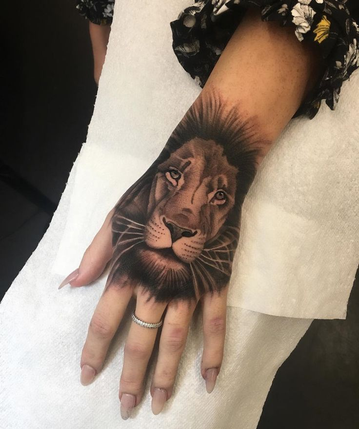 Majestic lion on girl's hand by Matt Stopps, an artist based in London, England.