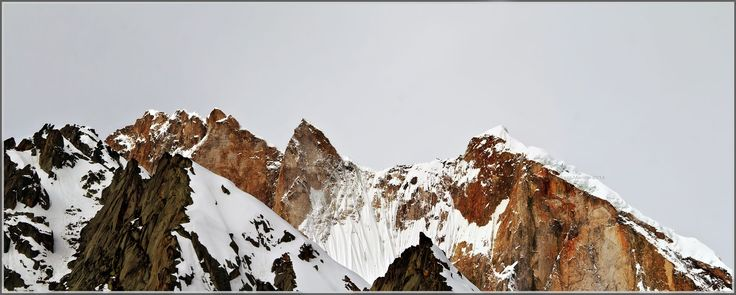 Mt Meru summits visible from Tapovan near to the Meru barmak(glacier) terminus.  The granite massifs are considered one of the most challenging ones and the Shark fin was climbed recently. Hindus and Jains folklore revere the peaks and consider them as the Centre of Universe