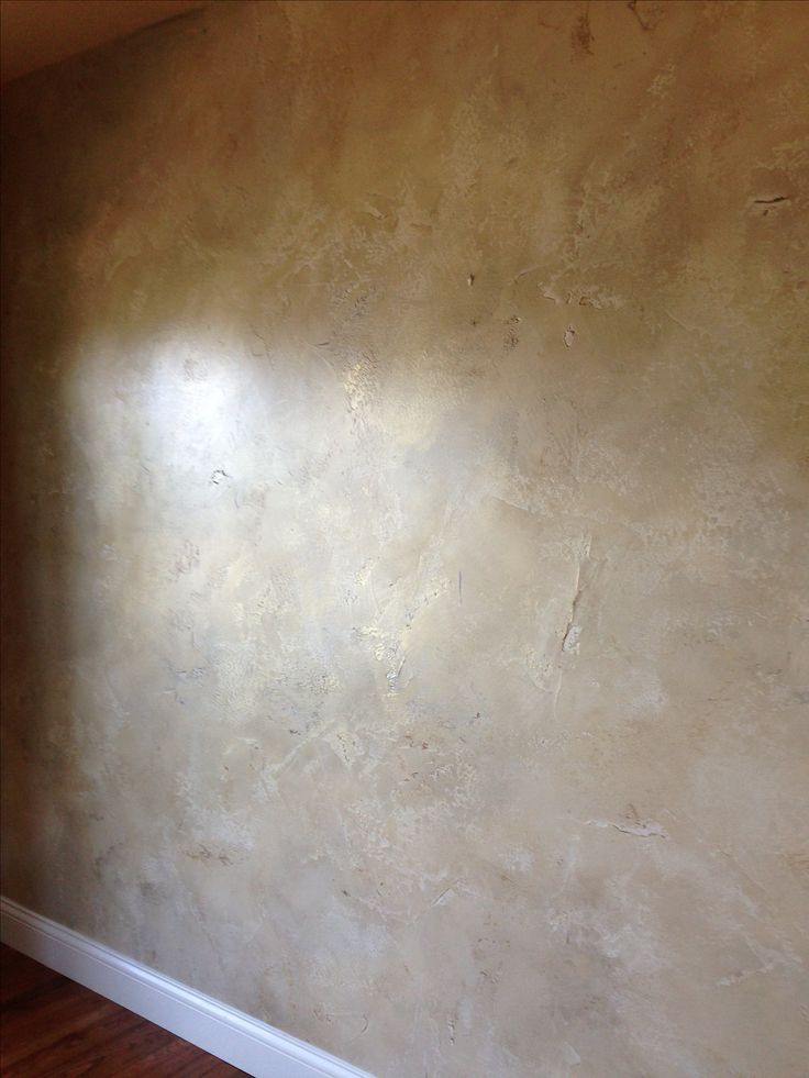 Venetian plaster walls.This was my former home.This look is achieved w/thin coats of plaster randomly placed on the wall .then numerous  coats of different colored  paints.the final step was a wax over the paint It's  a time-consuming process but worth it !