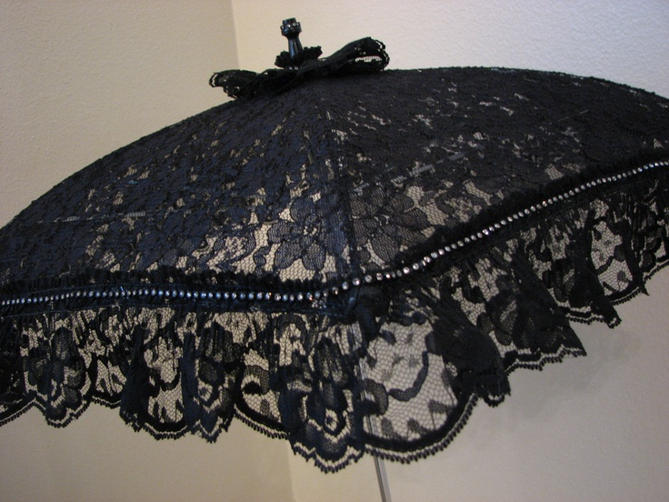 VICTORIAN PARASOL in Black Lace Embellished with Rhinestone Band and Black Lace Ruffle. $37.50, via Etsy.