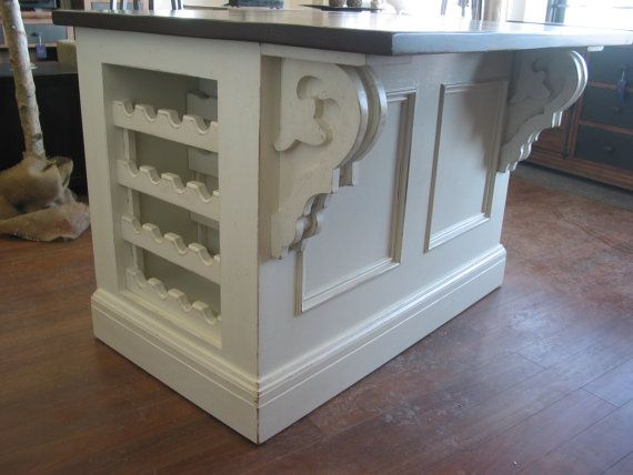 The kitchen island is 36 x 60  Has on one side over hang with corbels for comfortable seating for two  Top is made out of pine and stained in