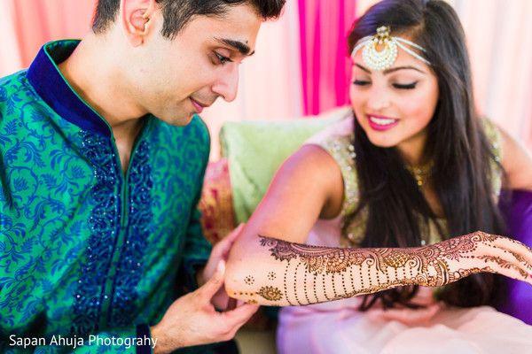 Groom admiring the bride's mehndi. http://www.maharaniweddings.com/gallery/photo/97654