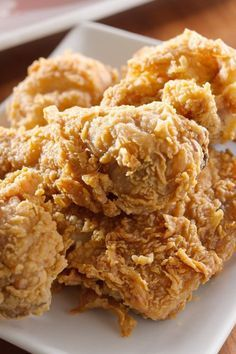 Paula Deen's Southern Fried Chicken Recipe. Made with eggs, hot red pepper sauce, self rising flour, pepper, chicken, peanut oil, salt, black pepper and garlic powder. Fried at 350 degrees.