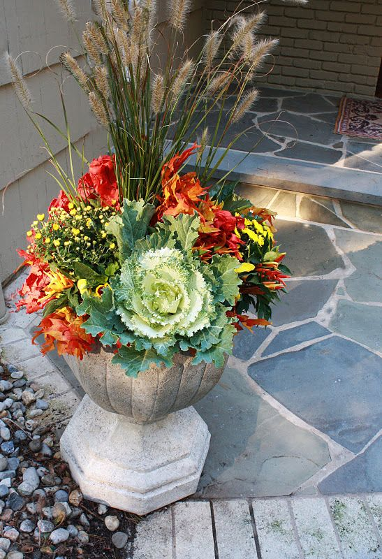 Fall Urn With Garden Mums Flowering Kale And Leaves 400 x 300