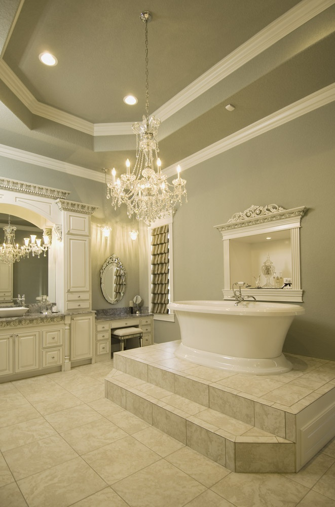 large elegant bathroom love the steps up to the tub