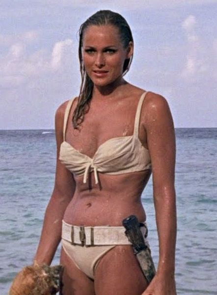50 Years of Bond Girl Fashion: Ursula Andress as Honey Ryder in Dr. No, 1962: The quintessential Bond girl, Andress' white cotton bikini launched a thousand copycats (and parodies). Definitely one of the most iconic costumes of all time.