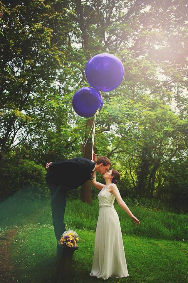 Photography purple balloons bride and groom