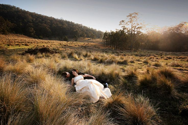 Bride & Groom + grassy field, mountains