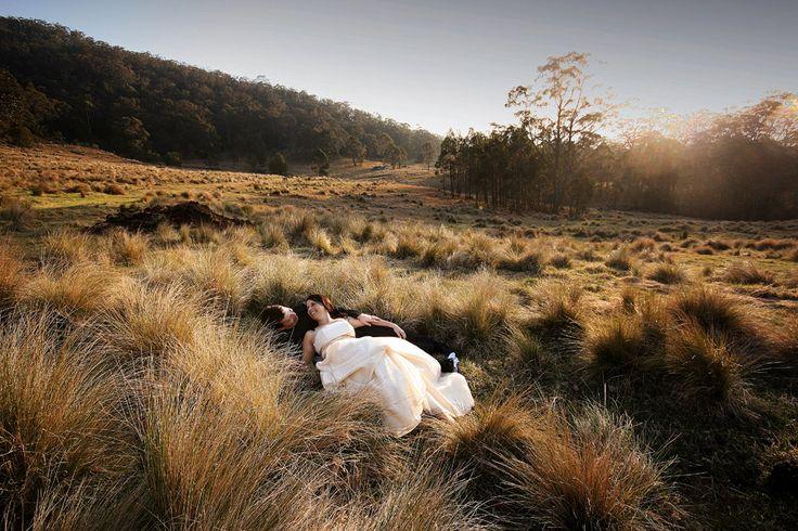 Bride & Groom + grassy field, mountains
