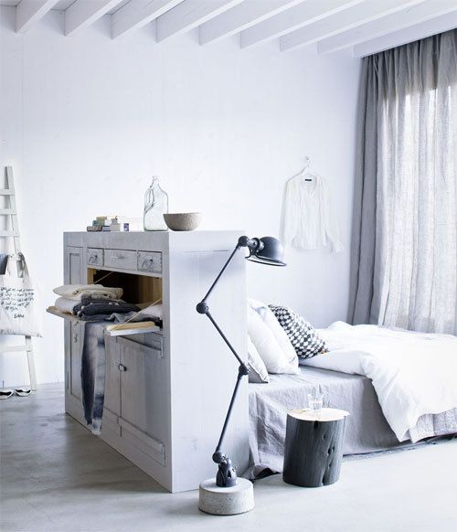 Bright bedroom in white and wood with a vintage dresser as a headboard via Home Decor Obsession