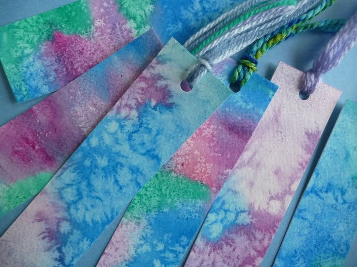 watercolor paper, watercolor paints, kosher salt ... wet paper, apply watercolor paints, let rest a bit, but not dry, sprinkle salt, let dry completely, brush off salt, can cut into strips & add a bit of yarn for bookmarks