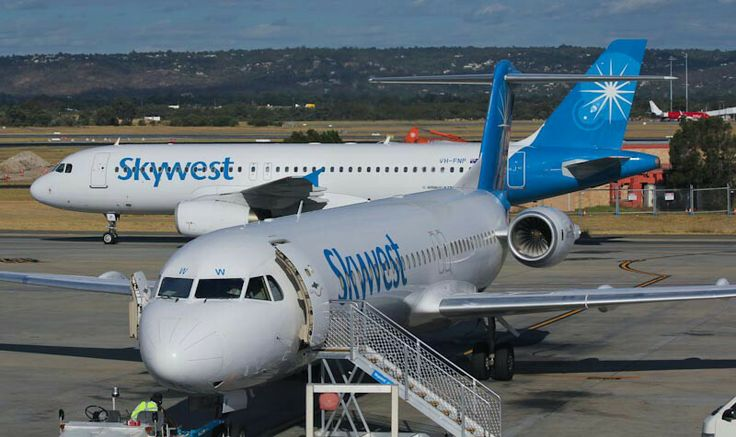 Skywest Airlines Fokker 100 with company A320 taxiing behind, Perth Airport