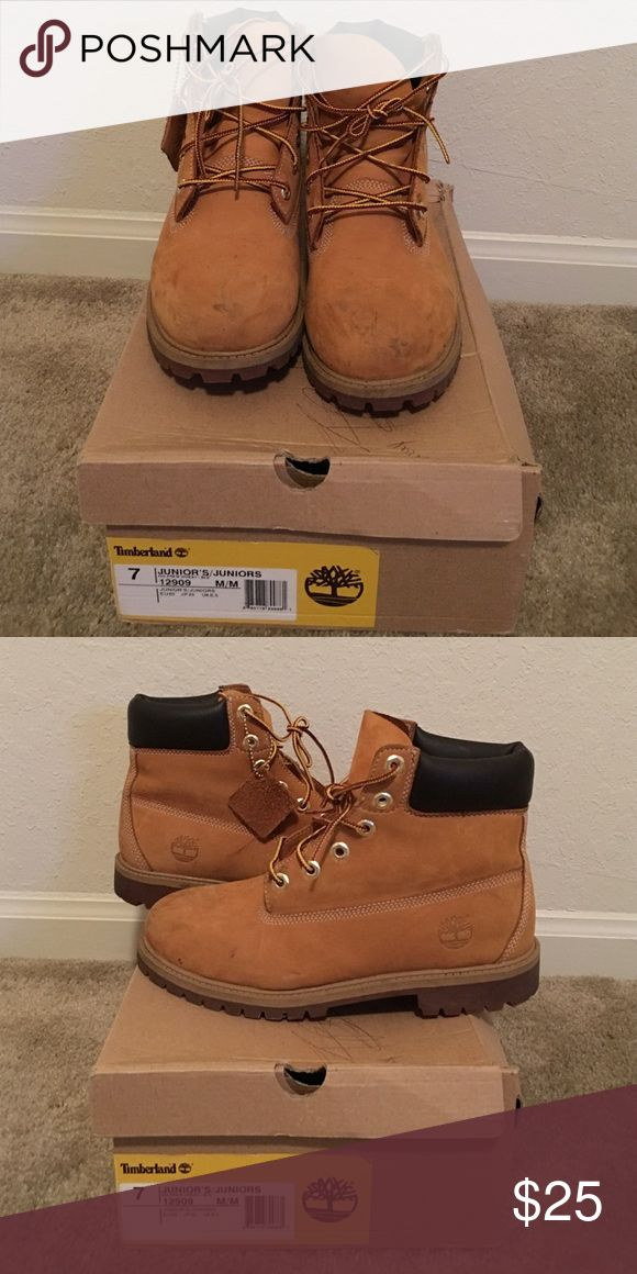 Timberland Boots Haven't worn these in about a year ! Have a few scuffs on the front but can be wiped off with a wet rag. These are great for winter and are a kids/juniors size 7. I wear a women's size 8.5/9 and can fit these ! They are technically a boys shoe Timberland Shoes Combat & Moto Boots