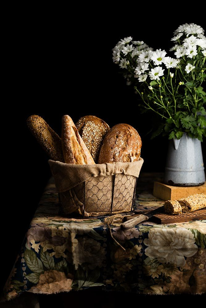 Still life of Bread and Daisies by Raquel Carmona