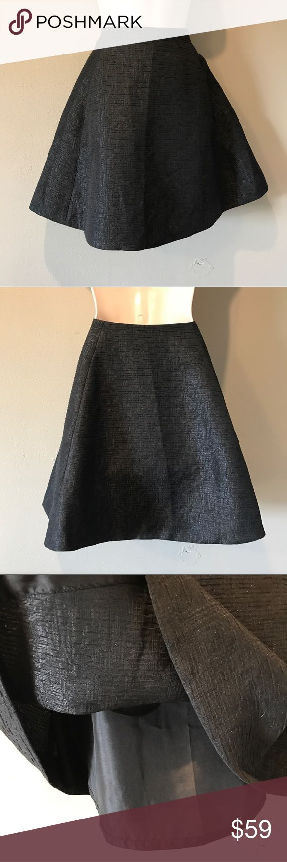 Kate Spade Black Circle Skirt, size 12 Adorable Kate spade black textured circle skirt in excellent pre-owned condition.  Fabric has a touch of metallic fiber which makes it sparkle :-) fully lined, size is 12 kate spade Skirts Circle & Skater