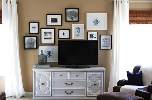 Groupings of pictures work better than one large picture-- flat screen can become part of the grouping