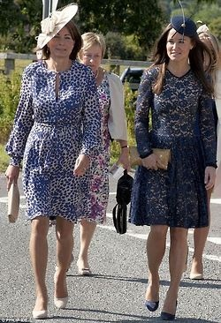elizabethswardrobe:    Carole Middleton and Pippa Middleton in Erdem at the wedding of Mary Bucknell and Simon Cox.