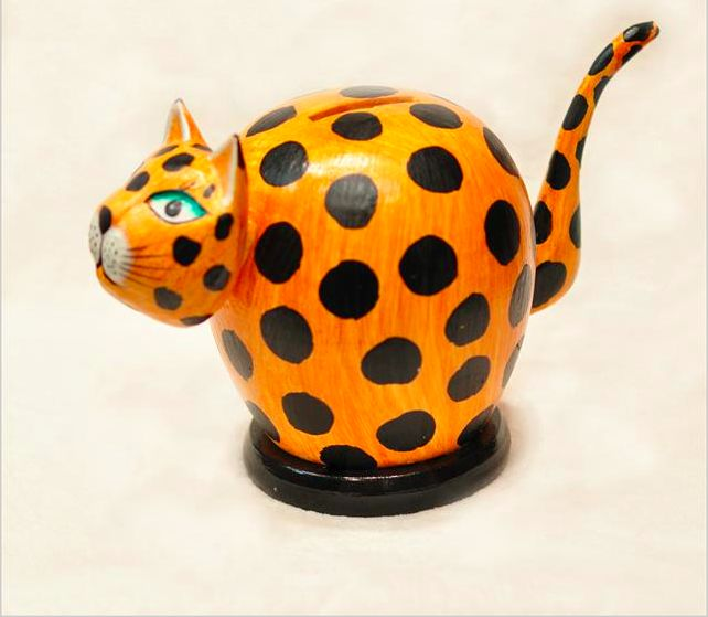This coy cat/cheetah money bank is hand crafted item in Bali  and is not mass produced or factory made.
