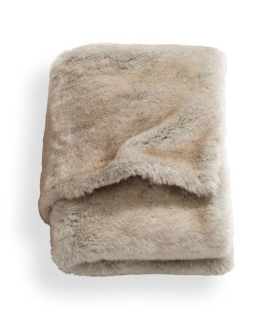 Throw in soft faux fur with a woven cotton backing. Size 30 x 51 in.